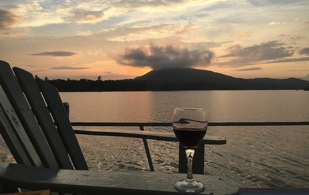 Sunset and wine with a view from Floating Camp Nomad's Upper Deck